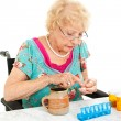 Disabled Senior Examining Her Medication — Stockfoto