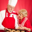 Baker Shares Cookies with Housewife — Stock Photo #22102999