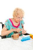 Disabled Senior Examining Her Medication — Stock Photo