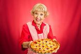 Granny Holding Lattice Top Cherry Pie — Stock Photo