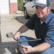 Mechanic Using Tire Iron — Stockfoto
