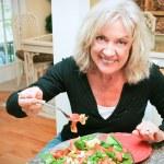 Sexy Senior Woman Eats Healthy — Stock Photo