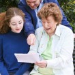 Family Reading Letter Together - Stockfoto