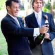 Gay Couple Opening Champagne — Stock Photo