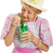 Tipsy Senior Lady Drinking Cocktail — Stock Photo #25807485