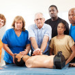 Stock Photo: Adult Education Class - First Aid - Serious