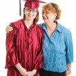 high school graduate and proud mom vertical — Stock Photo