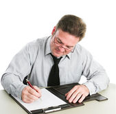 Businessman Writing on Legal Pad — Stock Photo