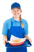 Teen Worker Serves Burger and Fries — Stock Photo