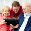 Family Using Tablet Computer — Stock Photo