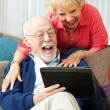 Senior Couple with Tablet PC - Laughing — ストック写真