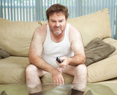 Couch Potato Watching TV — Stock Photo