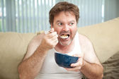 Couch Potato Eating Cereal — Stock Photo