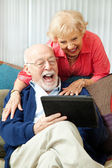 Senior Couple with Tablet PC - Laughing — Stock Photo