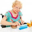 Stock Photo: Sorting Medication for Week
