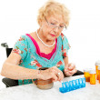 Stock Photo: Sorting Medication for the Week