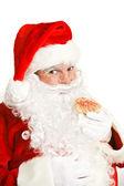 Santa Eating Christmas Cookie — Stock Photo