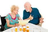 Senior Couple Discussing Medical Expenses — Stock Photo