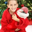 Little Boy Under Christmas Tree with Stocking — Stock Photo #34094861