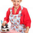 Sweet Grandma Ironing — Stock Photo #34094893