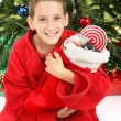 Little Boy Under Christmas Tree with Stocking — Stock Photo
