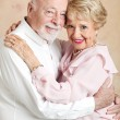 Seniors Embrace — Stock Photo