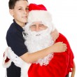 Boy Embracing Santa Claus — Photo
