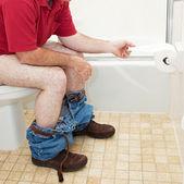Man Using Toilet Paper in Bathroom — Stock Photo