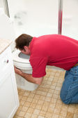 Man Vomiting in Toilet — Stock Photo