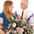 Husband Gives Flowers to His Wife — Stock Photo