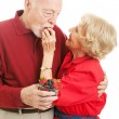 Healthy Senior Couple Eating Berries — Stock Photo