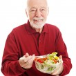 Healthy Senior Man Eating Salad — Stock Photo #39022681