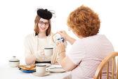 Mom Pours the Tea — Stock Photo