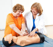 Mature Woman Learning CPR — Stock Photo