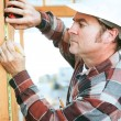 Construction Worker Takes Measurement — Stock Photo #46825719