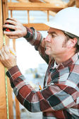 Construction Worker Takes Measurement — Stock Photo