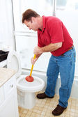 Man Plunging Toilet — Stock Photo