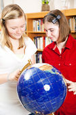 Library - Using Globe — Stock Photo