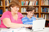 Library - Mother Son — Stock Photo