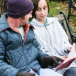 Homeless Family with Bible — Stock Photo #50215599