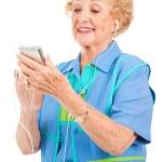 Senior Woman with Multi-Media Player — Stock Photo #6511381