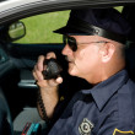 Police Officer on Radio — Stock Photo #6667856