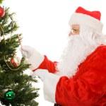Santa Decorating Christmas Tree — Stock Photo #6684614