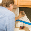 Setting Tiles with Care — Stock Photo #6684952