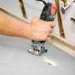 Spiral Saw Cuts Drywall — Stock Photo #6717494