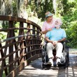 Senior Caretaker on Bridge — Stock Photo #6817018