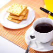 Hot coffee cup with bread on the work space — Stock Photo #12590654