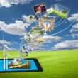 Stock Photo: Saving energy stream images from tablet pc on field with sol