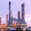 Royalty-Free Stock Photo: Scenic of petrochemical oil refinery plant shines at night, clos