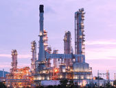 Scenic of petrochemical oil refinery plant shines at night, clos — Stock Photo